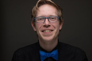 Jamie Eastgaard-Ross's Headshot from How to Succeed in Business Without Really Trying