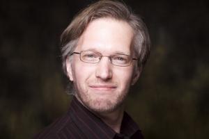 Janos Zeller's Headshot from Urinetown